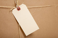 A Shipping Box Ties with string with a blank label Stock Photos