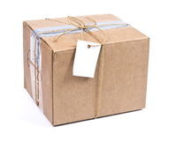 Shipping Box With Tag Stock Photo