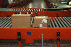 Shipping. Boxes at conveyer belt in distribution warehouse Royalty Free Stock Images