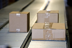 Shipping Boxes On Conveyor Belt Royalty Free Stock Photo