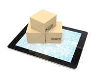 Shipping: cardboard package boxes on tablet Stock Photo
