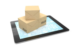 Shipping: cardboard package boxes on tablet Stock Photos