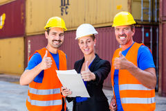 Shipping company workers in front of containers Royalty Free Stock Photo