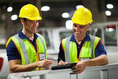 Shipping company workers. Two shipping company workers recording vehicles before exporting Stock Photography
