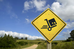Shipping concept delivery box cart on road sign Royalty Free Stock Photography
