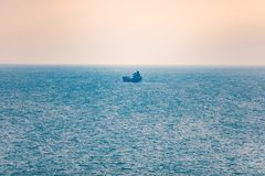 Shipping concept. Single tanker transporting goods in sea royalty free stock image
