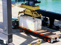 Shipping Container. Being loaded onto truck for transportation from wharf Stock Photos