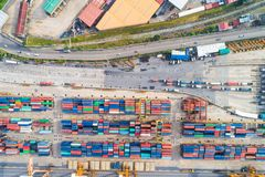 Shipping container cargo pier trade port in the city. Of riverside royalty free stock photos