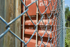 Shipping container close up security fence Royalty Free Stock Photography