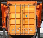 Shipping container. Loading orange cargo shipping container at truck trailer Royalty Free Stock Photos
