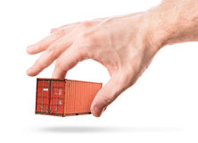 Shipping container in man's hand Royalty Free Stock Photo