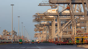 Shipping container port cranes stock photo