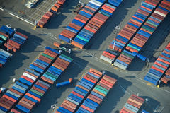 Shipping Container Rows. Aerial View of trucks loading and unloading shipping containers Stock Image