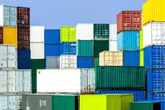 Shipping container stack in diverse, harmonious colors Royalty Free Stock Image