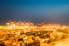 Shipping container terminal at night. Busy modern harbor in shanghai, China Stock Image