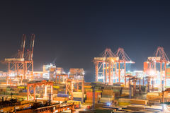 Shipping container terminal at night. Busy modern harbor in shanghai Royalty Free Stock Image