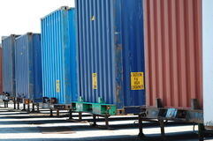 Shipping Containers. A line of shipping containers waiting for transport stock images