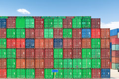 Shipping containers against a blue sky Stock Image