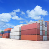 Shipping containers in cargo port Stock Photos