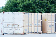 Shipping containers on construction site. Shipping containers used for storing tools and equipment on a construction site Royalty Free Stock Photo