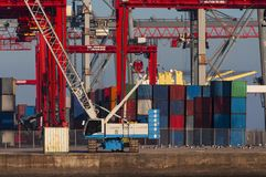 Shipping containers and cranes at the Lisbon Port. In Portugal stock photo