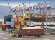 Shipping containers at dock Stock Photography