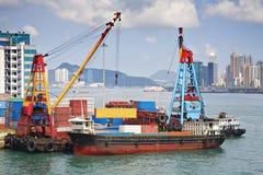 Shipping Containers Hong Kong. Stock photo of unloading shipping containers from a lighter in Victoria Harbour, Hong Kong stock image