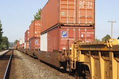 Shipping Containers loaded on a train Stock Images