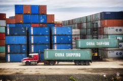 Shipping containers loading on truck Royalty Free Stock Image