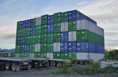 Shipping containers piled up in the port of Anchorage Royalty Free Stock Photography