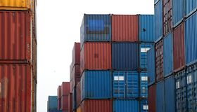 Shipping Containers placed as layered in the storage facility. An object that can be used to hold or transport something royalty free stock photo