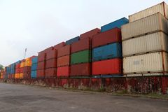 Shipping Containers placed as layered in the storage facility royalty free stock images