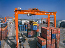 The Shipping containers from Port. Moving containers from truck in Port Royalty Free Stock Photography