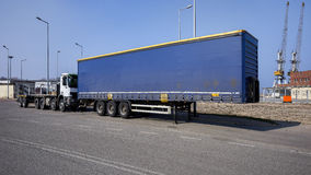 Shipping containers and semi truck Royalty Free Stock Images