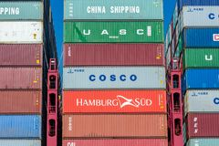 Shipping containers stacked on each other closeup Stock Photos