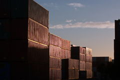 Shipping containers stacks at port. Cargo shipping containers stacked in morning sun Stock Photos