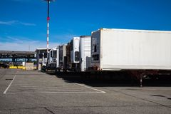 Shipping containers waiting to  be delivered to customers. Shipping containers waiting to  be picked up and delivered to customers Stock Photography
