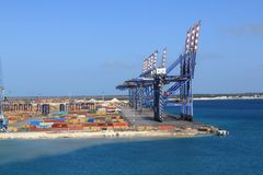 Shipping cranes at Freeport, Bahamas. Large Shipping cranes for moving containers stand ready for action at Freeport, Bahamas stock image