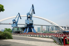Shipping Cranes and Lupu Bridge Shanghai Stock Photography
