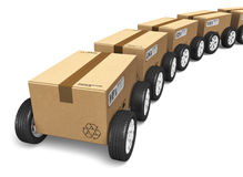 Shipping and delivery concept. Shipping, logistics and delivery concept: railway freight cargo train from heap of cardboard boxes with car wheels isolated on Stock Images