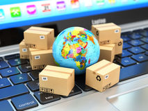 Shipping, delivery and logistic concept. Earth and cardboard box Stock Photo