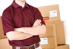 Shipping: Delivery Man With Arms Crossed Royalty Free Stock Photography