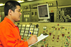 A shipping engineer. Near a panel of ship's automation Stock Image