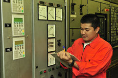 A shipping engineer. Near a panel of ship's automation Royalty Free Stock Photography