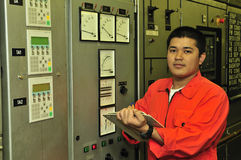 A shipping engineer. Near a panel of ship's automation Royalty Free Stock Image