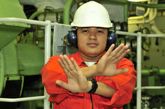 A shipping engineer. Near a panel of ship's automation Stock Photo