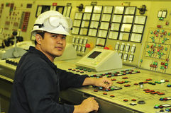 A shipping engineer. Near a panel of ship's automation Stock Photography