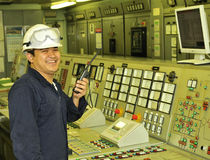 A shipping engineer. Near a panel of ship's automation Royalty Free Stock Photos