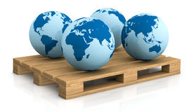 Shipping everywhere. Four world globes showing different areas on a pallet; concept of shipping everywhere (3d render Stock Image