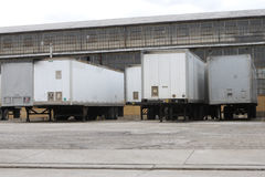 Shipping Facility. Trailers at warehouse Royalty Free Stock Image